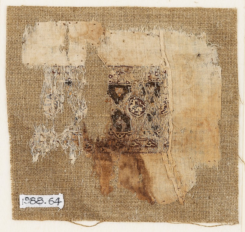 Textile fragment with band of decoration (front           )