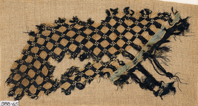 Textile fragment with grid and swastikas (front           )