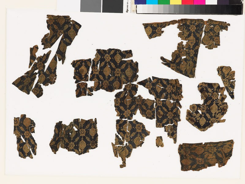 Group of textile fragments with medallions and stars (EA1988.66, front           )