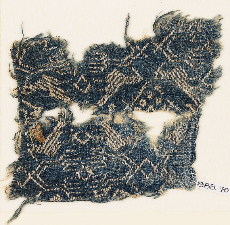 Textile fragment with birds and 'hand of Fatima' (EA1988.70, front           )