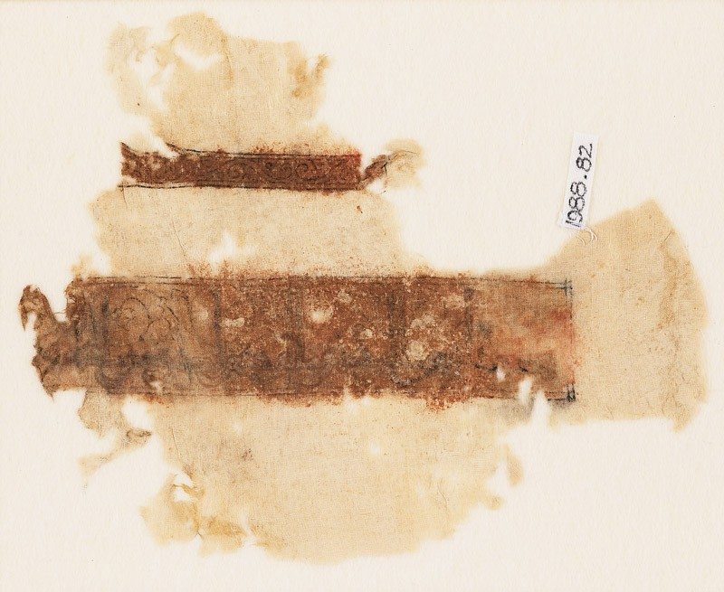 Textile fragment with band of Kufic inscription and vine with tendrils