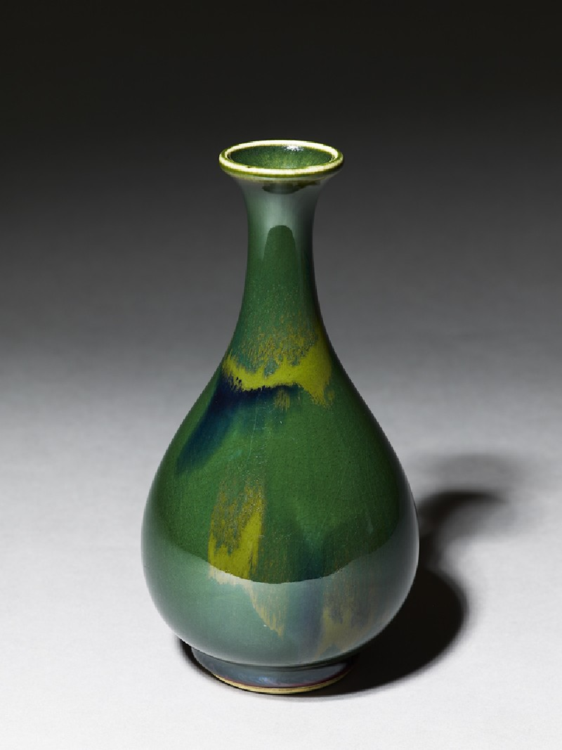 Pear-shaped bottle with a green 'flambé' glaze (oblique           )