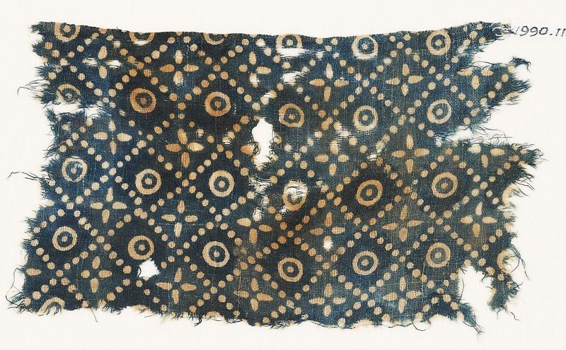 Textile fragment with dots, quatrefoils, and circles