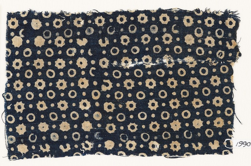 Textile fragment with rings, stars, and dots (EA1990.115, front            )