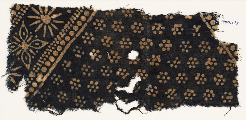 Textile fragment with rosettes and band with floral shapes (front            )