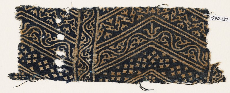 Textile fragment with linked chevrons, vine, and stars