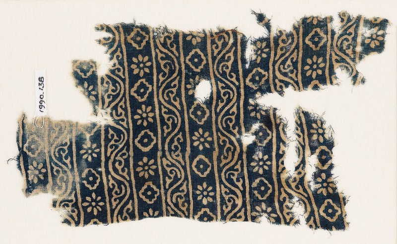 Textile fragment with bands of vines, rosettes, and diamond-shapes