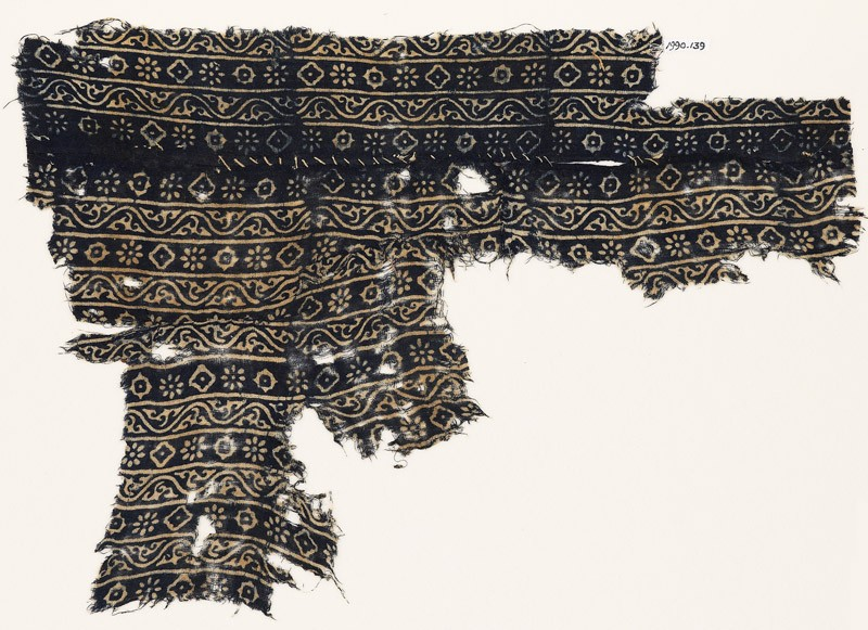 Textile fragment with vines, rosettes, and diamond-shapes (EA1990.139, front            )