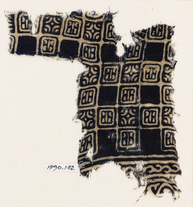 Textile fragment with linked squares, stylized flower-heads, and lines with dots