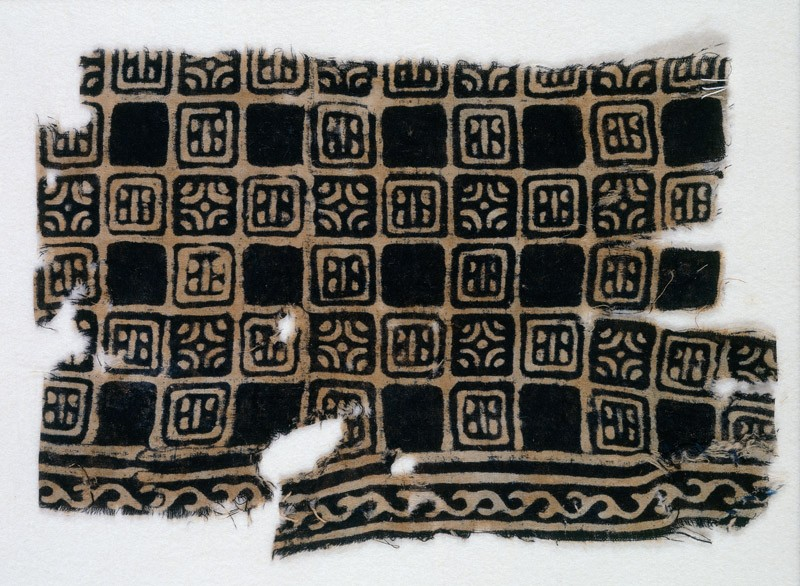 Textile fragment with linked squares, stylized flower-heads, and lines with dots (EA1990.143, front            )