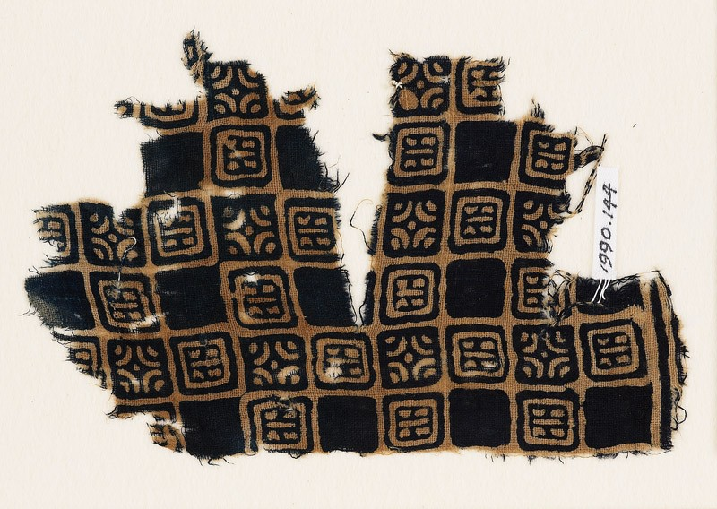 Textile fragment with linked squares, stylised flower-heads, and lines with dots