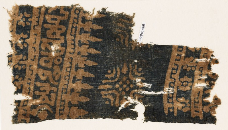 Textile fragment with Arabic-style script, rosettes, and stylized trees or foliage (front            )