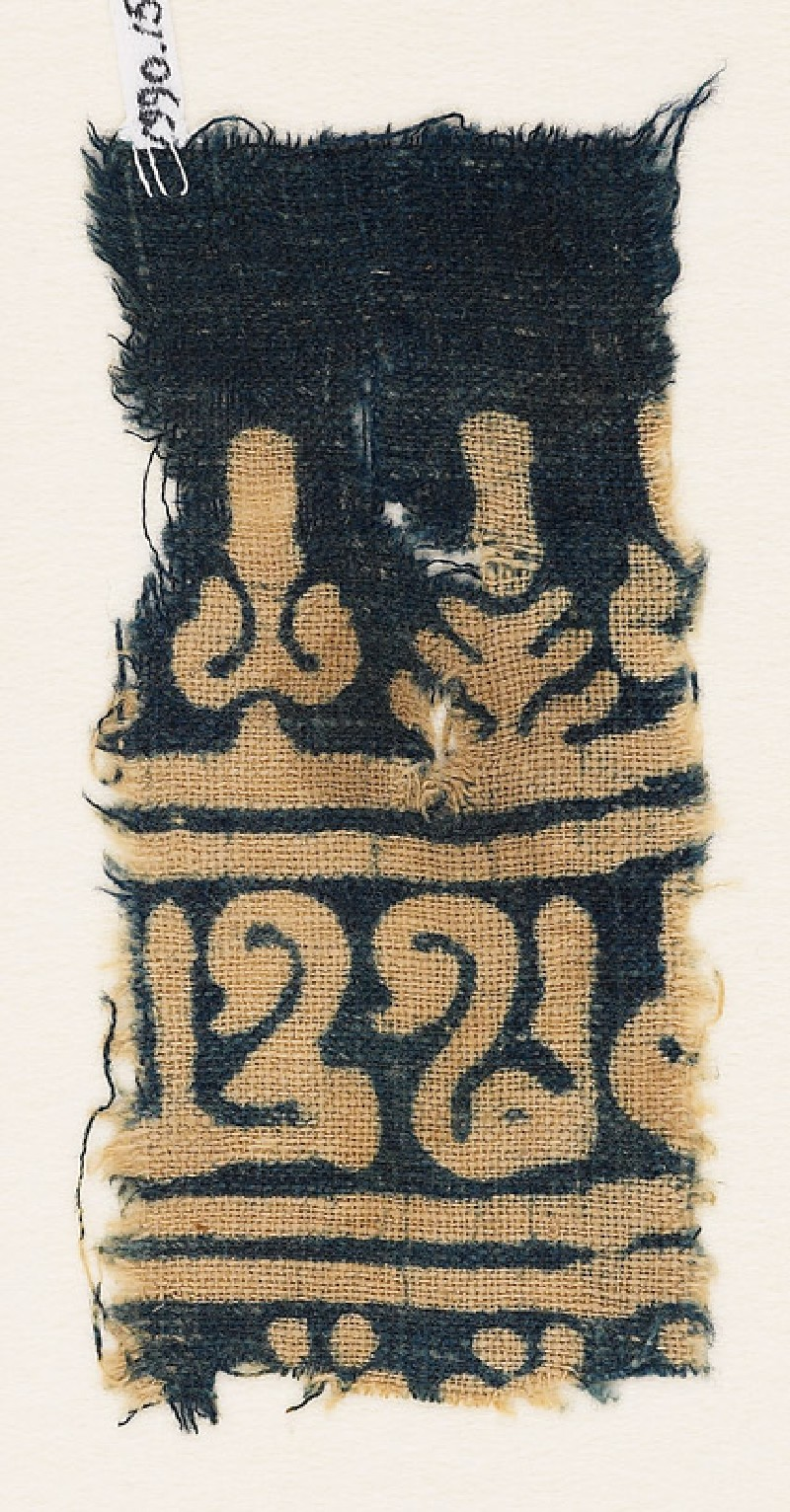 Textile fragment with inscription, stylized tree, and palmette