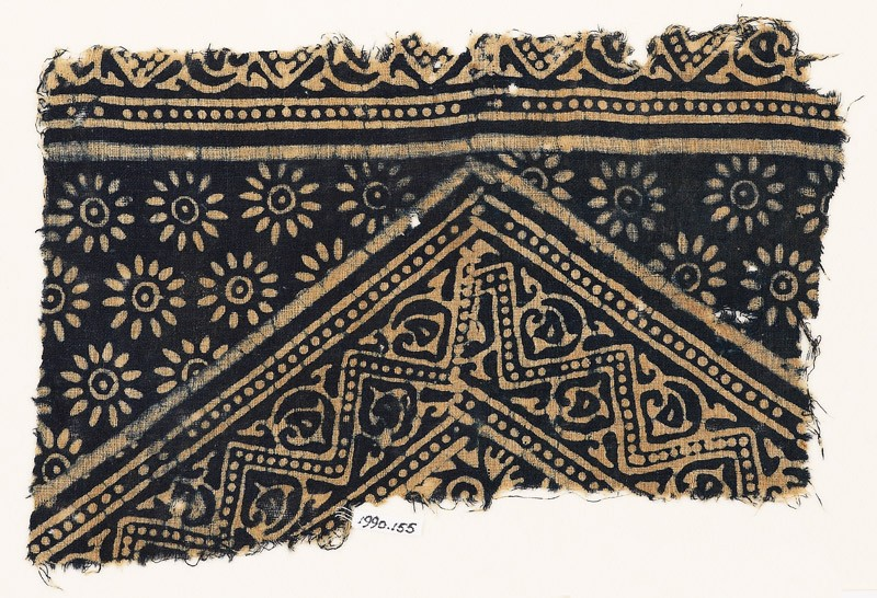 Textile fragment with dotted zigzags, leaves, and rosettes