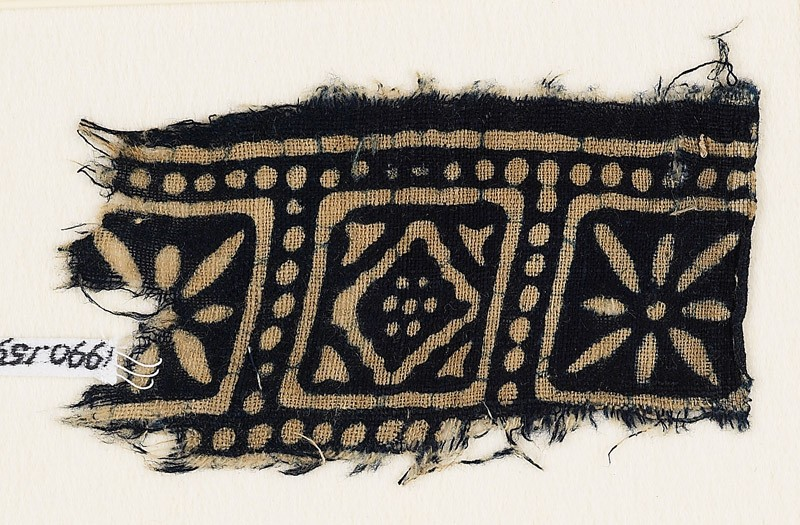 Textile fragment with squares, rosettes, and a diamond-shape (front            )