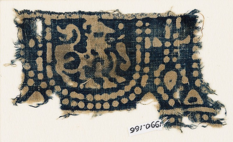 Textile fragment with pearl garland and stylized mythical animal
