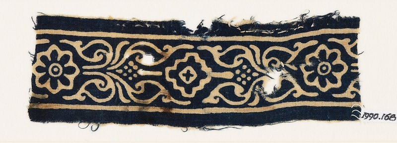 Textile fragment with rosettes, stylized leaves, and a diamond-shape (EA1990.168, front            )