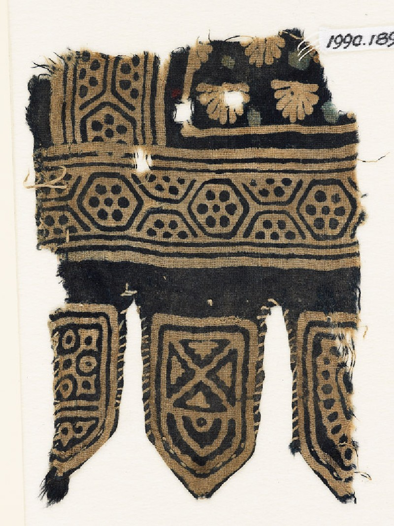 Textile fragment with hexagons and palmettes, and three tabs
