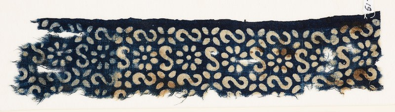 Textile fragment with S-shapes, rosettes, and flowers (EA1990.19, front           )