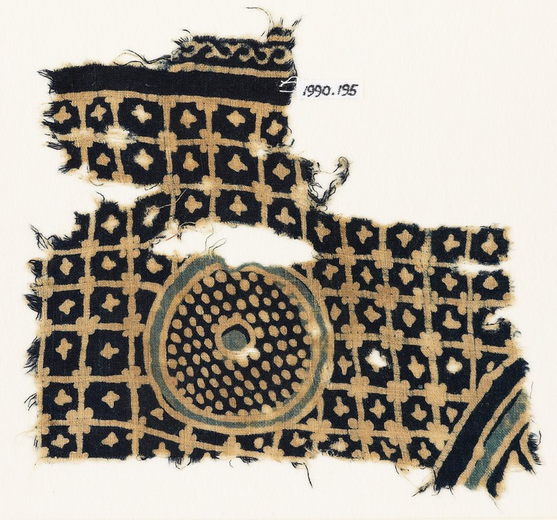 Textile fragment with grid, stars, and a circle with dots