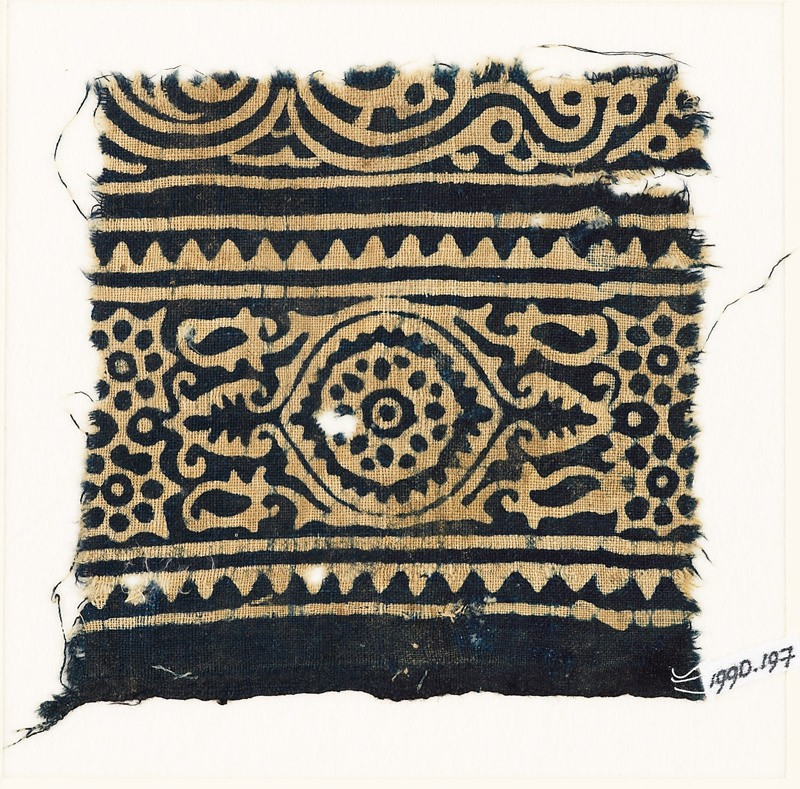 Textile fragment with medallion, and rosettes set into linked stars