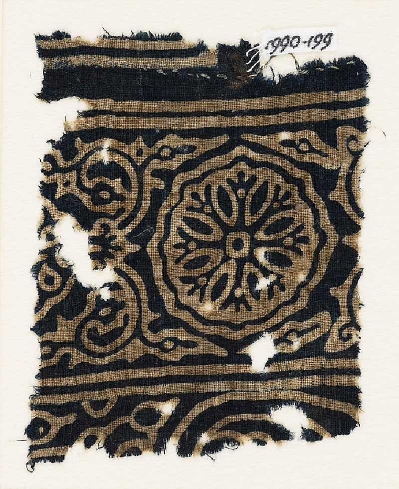 Textile fragment with ornate rosette, and tendrils with flower-heads