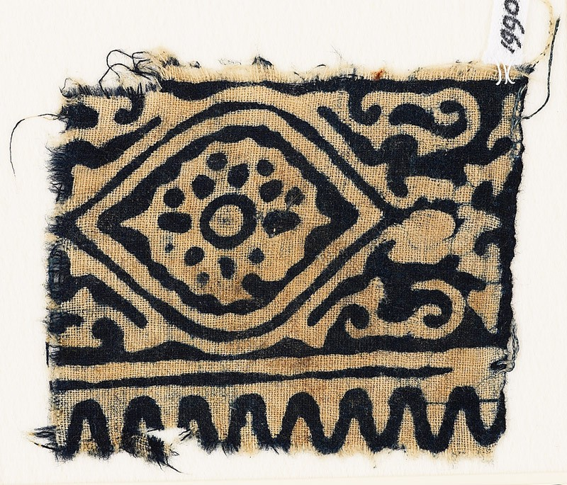Textile fragment with medallion, flower, and tendrils