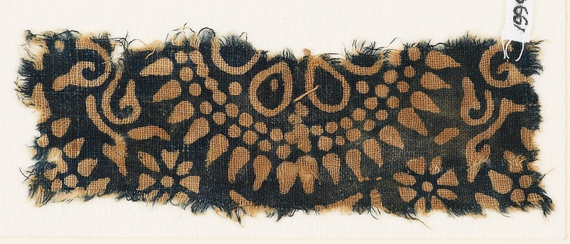 Textile fragment with part of a large rosette, surrounded by dots and petals (EA1990.208, front            )