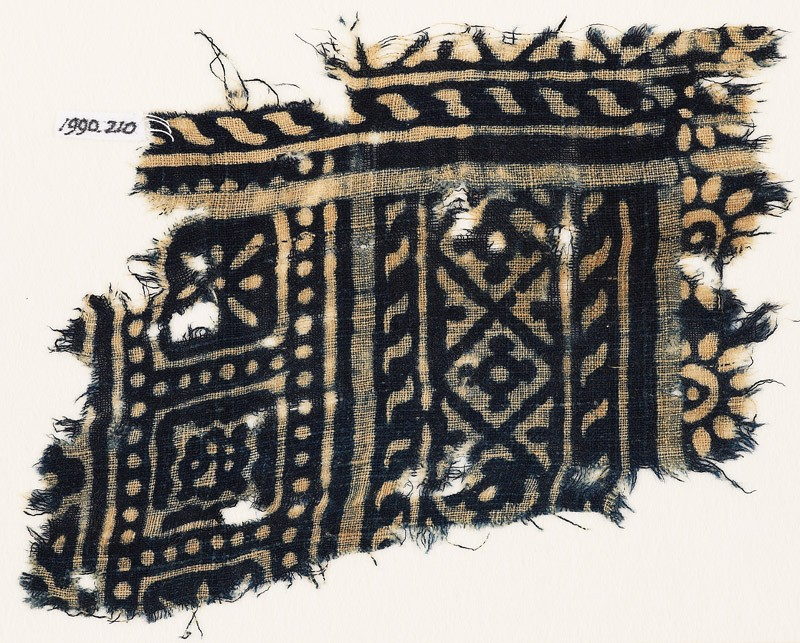 Textile fragment with diamond-shapes, and squares with rosettes (EA1990.210, front            )