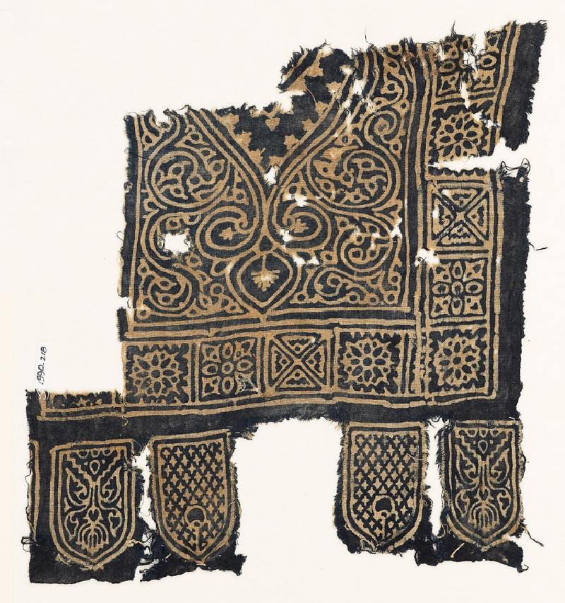 Textile fragment with medallion, squares with quatrefoils and rosettes, and tabs (EA1990.218, front            )