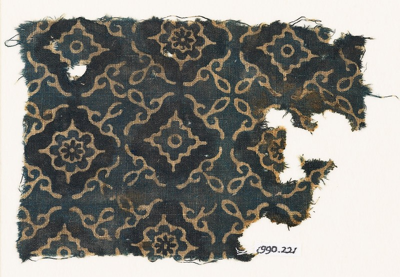 Textile fragment with lobed diamond-shapes and stylized leaves