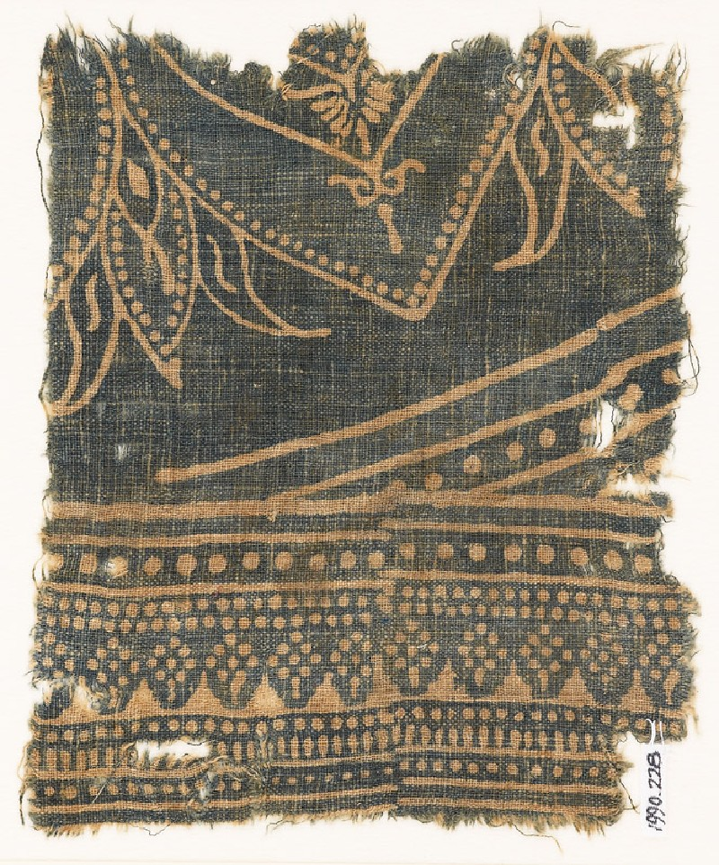 Textile fragment with arches and dotted rosettes (EA1990.228, front            )