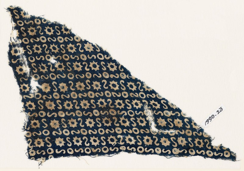 Textile fragment with S-shapes, circles, and stars (EA1990.23, front           )