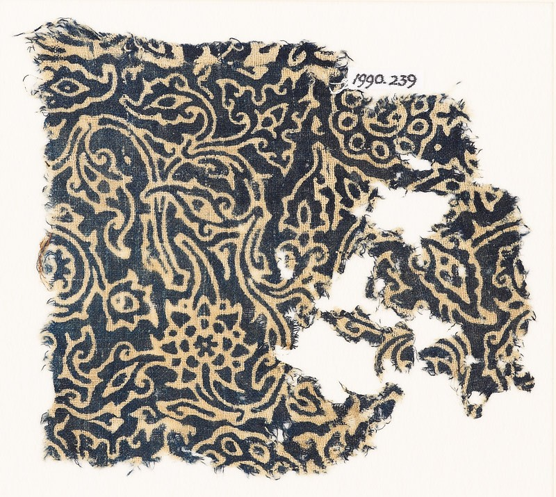 Textile fragment with swirling plants and flower-heads (EA1990.239, front            )