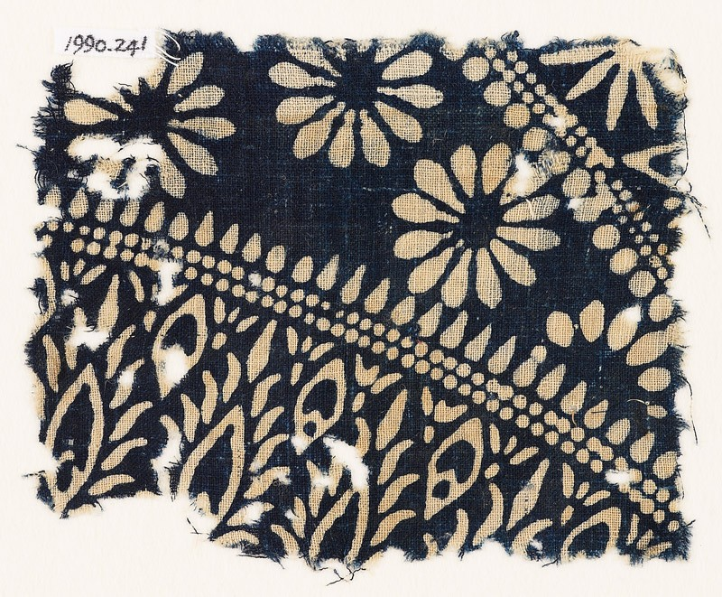 Textile fragment with rosettes and stylized plants