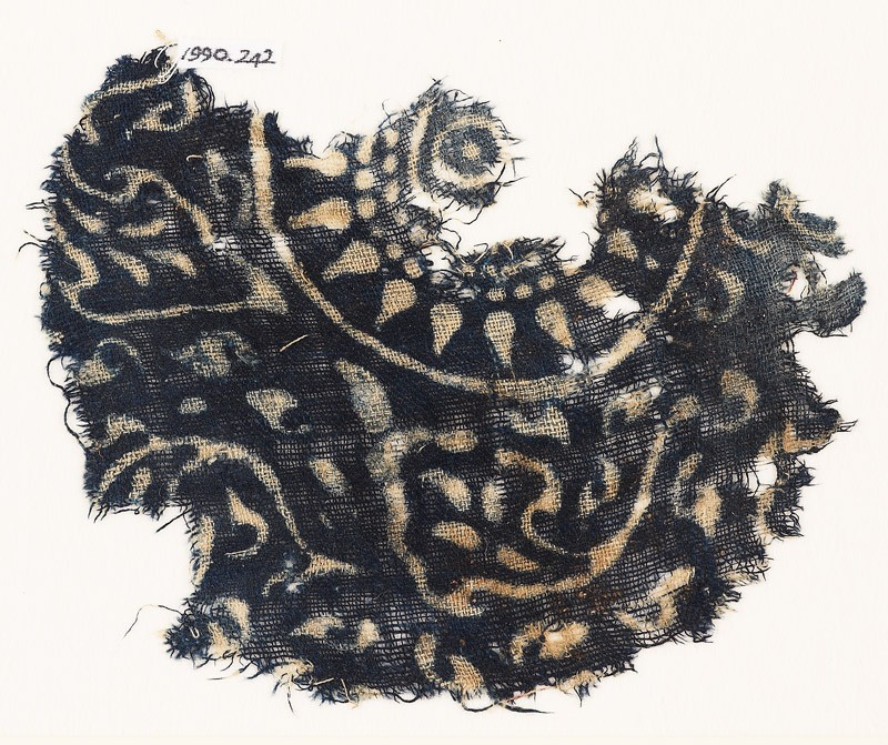 Textile fragment with medallion, rosette, and stylized leaves (front            )