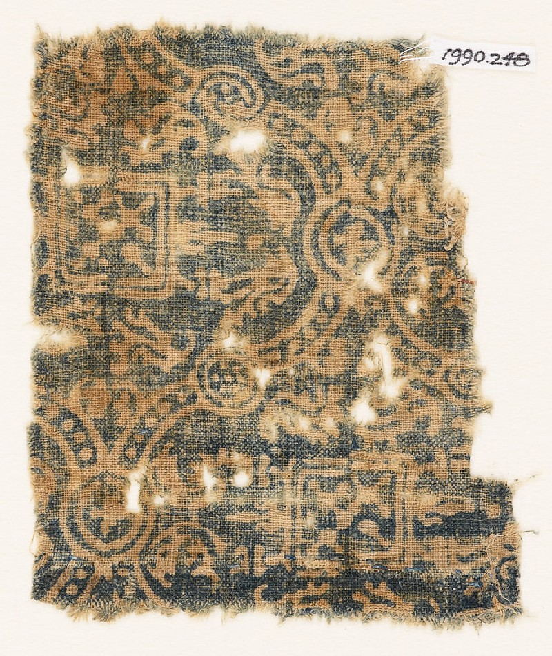 Textile fragment with linked medallions, stylized leaves, and squares