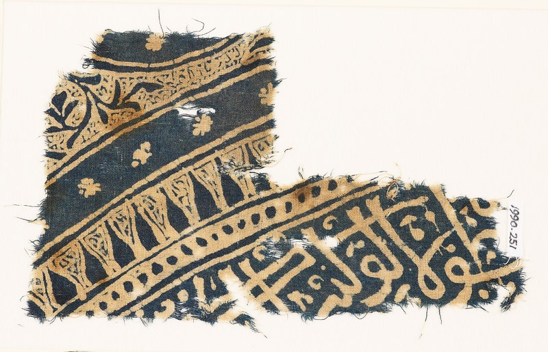 Textile fragment with Arabic or Persian script (EA1990.251, front            )