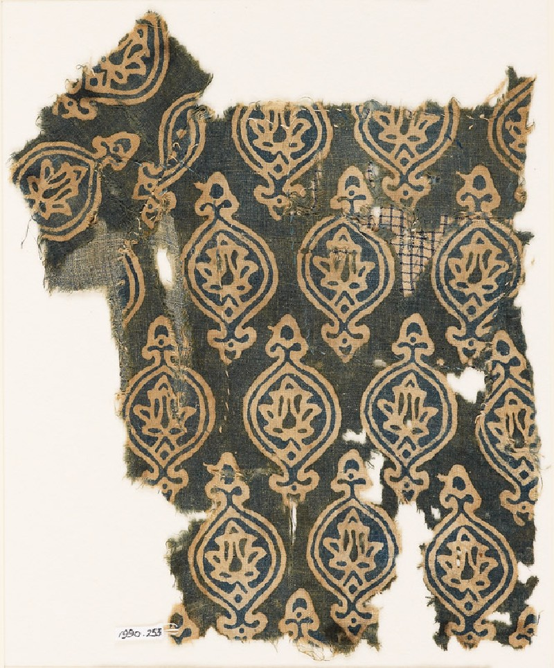 Textile fragment with ovals and stylized floral shapes