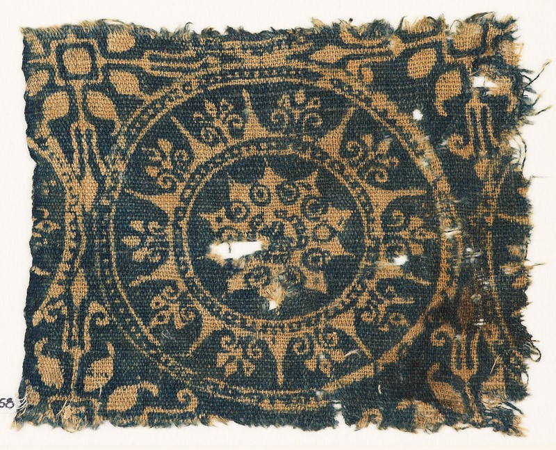 Textile fragment with medallion and stars (EA1990.258, front            )