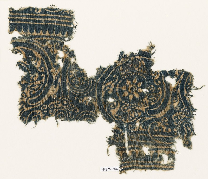 Textile fragment with linked scrolls (front            )