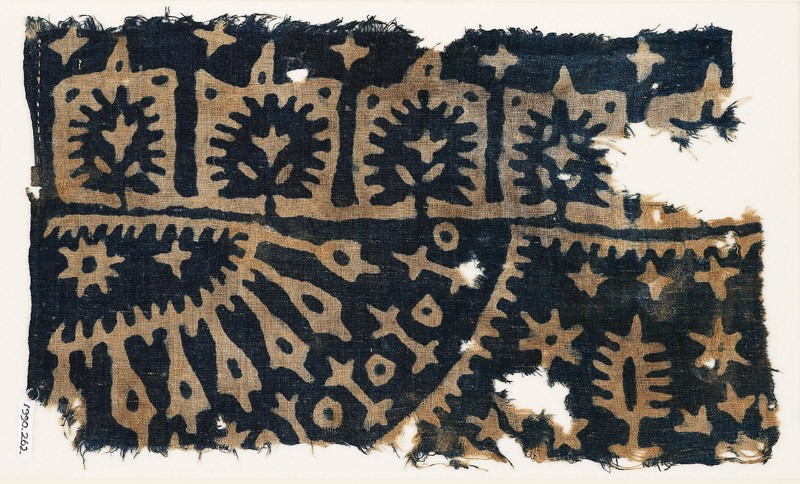 Textile fragment with trees, stars, and radiating shapes (front            )