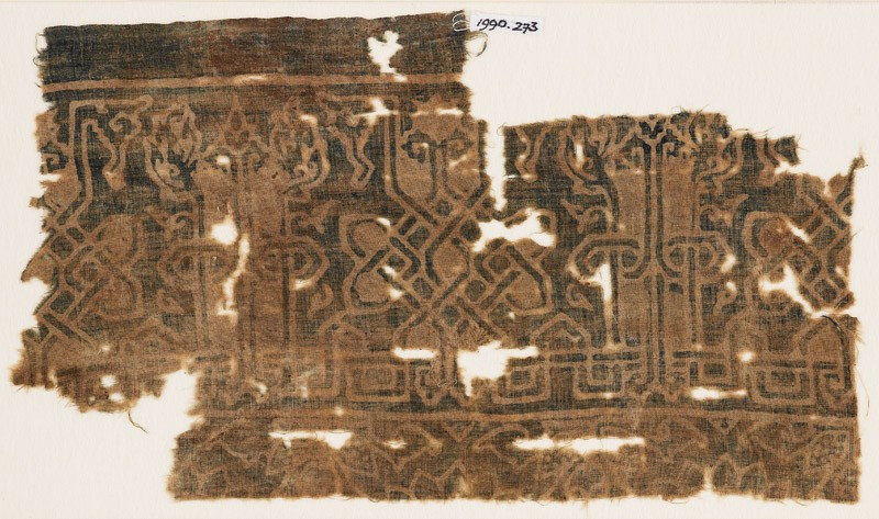 Textile fragment with interlace based on script, leaves, and tendrils (front            )