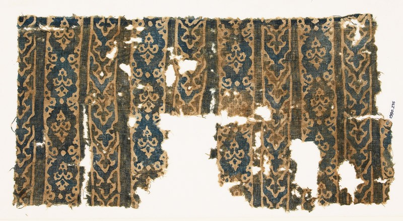 Textile fragment with bands of interlocking chevrons and linked medallions