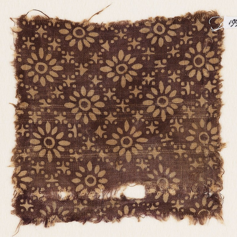 Textile fragment with rosettes in a grid of stars and dots