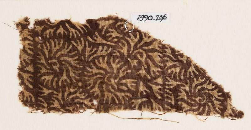 Textile fragment with swirling leaves