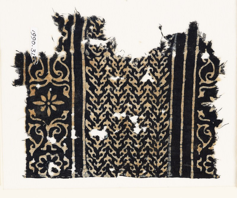 Textile fragment with linked chevrons, flowers, and leaves