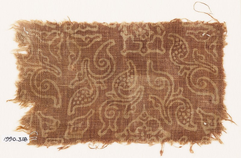Textile fragment with stylized plants and quatrefoils (front            )