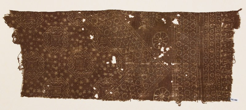 Textile fragment with rosettes, stars, and octagons