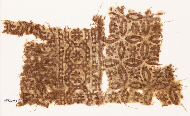 Textile fragment with rosettes, roundels, and quatrefoils